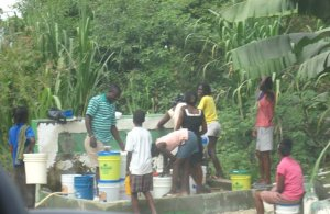 people fetching water