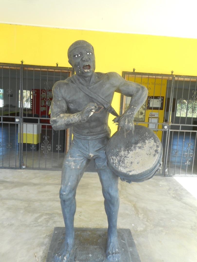 drummer in front of garifuna museum