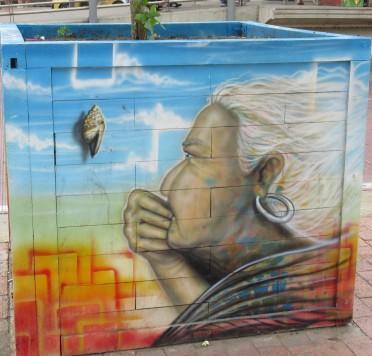 old woman watching seashell